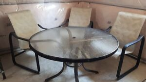 Glass Table and 4 chairs London Ontario image 1