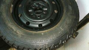 Firestone Winter tires 215/70 15 on rims ALMOST NEW