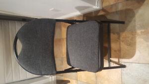 Grey padded steel folding chair