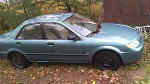Mazda Protege for parts or repair something wrong with the trans
