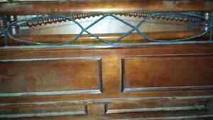 Queen size sleigh bed with wrought iron accents/inserts