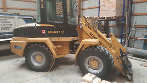 Schaeff 833 Loader with quick release forks