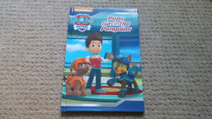 3 Paw Patrol books and a movie Projector