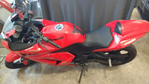 Red Ninja Kawasaki, great condition, $1800, obo.