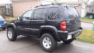 """02 jeep liberty with moab rims and 2.5"""" leveling kit"""