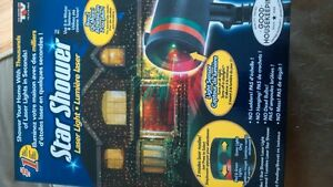 star showerlaser light-never used