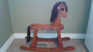 Small child's antique style wooden rocking horse