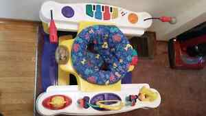 Fisher price step & play piano exersaucer