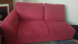 Harvey's red L shaped sofa