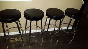 4 leather bar stools- great condition $200 obo