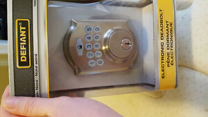 Electronic deadbolt alarm system. Make an offer