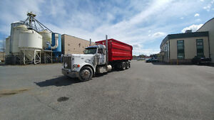 Roll off bin truck and transfer trailer with bins