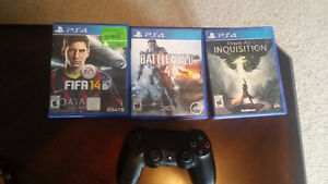 PS4 500 GB w 3 games and 2 controllers