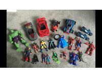Superhero figures and vehicles