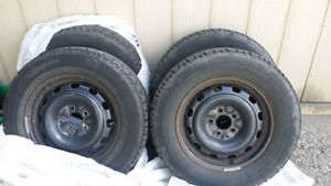 4 Snow Tires on Universal Rims