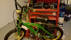 Boys john deer bike with helmet