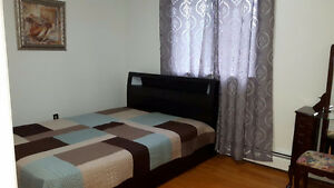 Large furnished bedrooms for females on main floor available