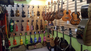 brand new acoustic and acoustic-electric Ukuleles