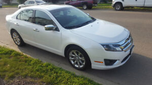 2012 Ford Fusion SEL, V6, all wheel drive, winter tires, low KMs