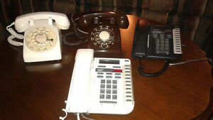 Selection of seven old corded phones, rotary dial and pushbutton