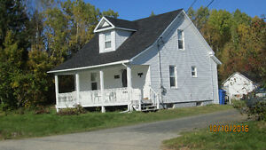 In Miramichi   story and one half house on acre of land