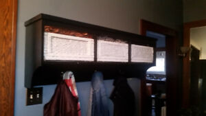 Hanging coat rack with storage baskets