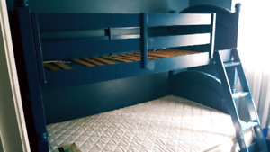 Kids bunk bed with trundle.
