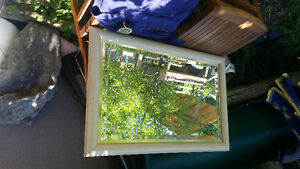 Great framed mirror with beveled  edges.  Only $ 20, reduced.