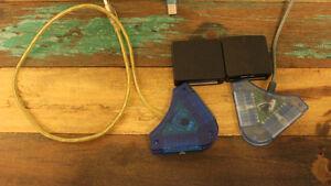 Plusieurs câbles, calculatrice, chargeur Canon, écouteurs