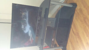 Two tvs & stand for sale