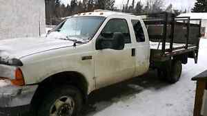 1999 dually F-350 7.3l diesel with hydrolic lift gate!