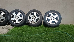 Lincoln LS mags with tires best offer must see just take em free