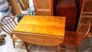 Solid wood drop leaf table and 2 chairs