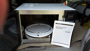Fridgidaire convection/ mic. Paid 500 asking 150 not used much.