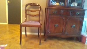 Antique carved back chair with needlepoint seat