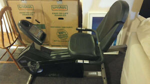 Universal Recumbent Exercise bike barely used paid $800