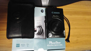 Canon PowerShot Elph 320 HS point and shoot camera with case