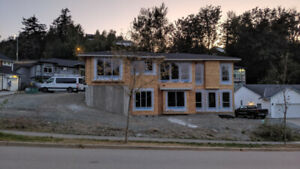 Luxury Rancher with Triple Garage and Space for a Legal Suite!!