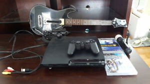 PS3 with Original/Move Controllers, Two Games, and Guitar