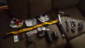 Variety of old camera lenses and camera tripods