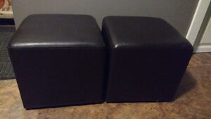 2 faux leather ottomans