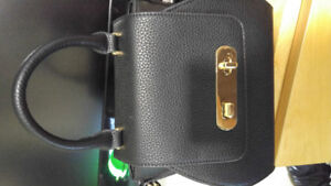 Ladies black purse brand new and sold as you see it! NEED GONE