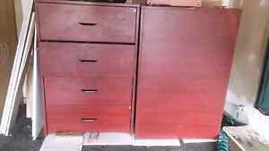 Two nice brown wooden filing cabinets