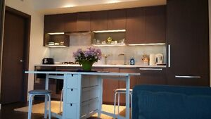 coffee table, white table , dinner table , tv in yaletown