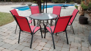 Patio Glass table and 6 red chairs