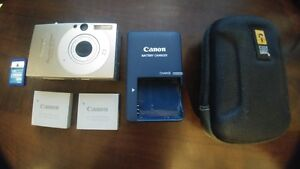 Canon PhotoShot SD1000 2 batteries 1GB Memory card