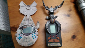2 older star wars hand held video games