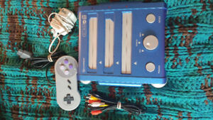 Retron 3 console with SNES controller