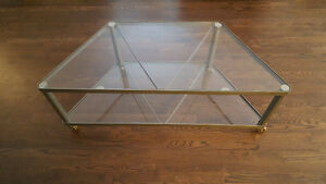 Glass and metal TV table on wheels