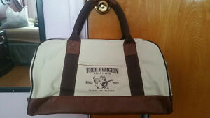 NEW WITH TAGS TRUE RELIGION CANVAS DUFFEL BAG (INCLUDES LONG STR